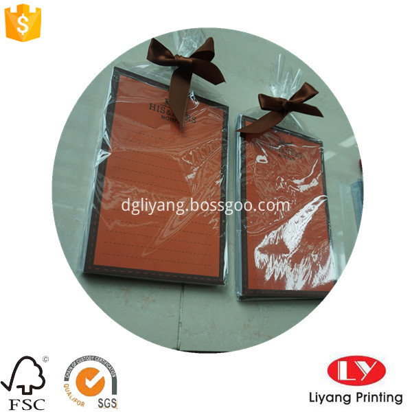 notepad with plastic bag