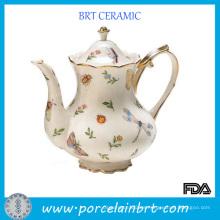Tetera de cerámica elegante con borde dorado