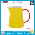 Jarra de agua de cerámica amarilla de alta calidad con mango rojo