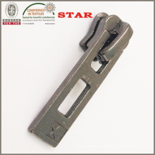 Extractor de metal para cremallera metálica