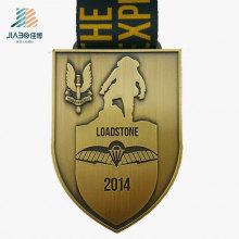 China Fornecimento de Fábrica Bronze Personalizado Medalha de Desafio De Metal com Fita