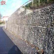 Сетка gabion использована для предохранения от наклона дороги