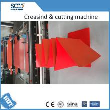 Máquina automática de dobra e de corte do papel