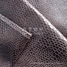 Tejido de cuero sintético bronceado con respaldo para tapicería