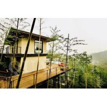 Edificio Turístico Verde y Prefabricado