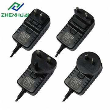 Adaptador de corriente de enchufe de viaje intercambiable de 12V1.5A 18W