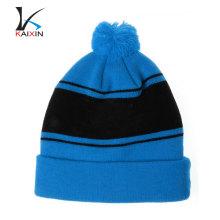 Sombrero de gorra de Hip Hop azul de alta calidad personalizado con pompón Gorro de invierno de punto / gorro negro al por mayor con logo de bordado de apliques