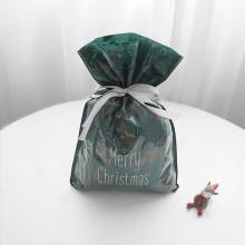 Grüne Blätter Weihnachtsplastik-Geschenkverpackungstasche