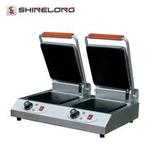 Machine commerciale de gril de cuisine de contact de doubles têtes commerciales de K406