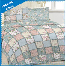 Couette en patchwork de coton imprimé jardin fleuri