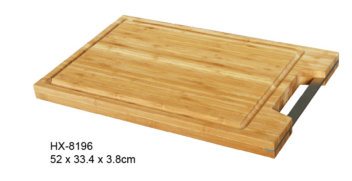 bamboo cutting board with metal handle and drip groove