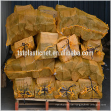 Brennholz Netztasche mit bedrucktem Markenetikett