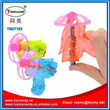 Wind up fliegende Untertasse Disc UFO Gun Spielzeug mit Süßigkeiten