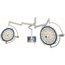 Emergency dual head lamp with camera system
