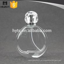 Botella de cristal vacía del perfume redondo 100ml con el rociador