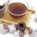 Chinese herbal tea, compressed Pu'er Tuo Cha (Ripe Pu'er Tuo Cha)