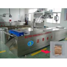 Continuous stretch film vacuum sealer for small bags