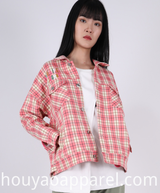 Cropped check coat with a lapel collar and long sleeves with buttoned tab detail