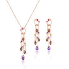 Conjunto elegante de joyas de piedra multicolor con borlas largas de moda