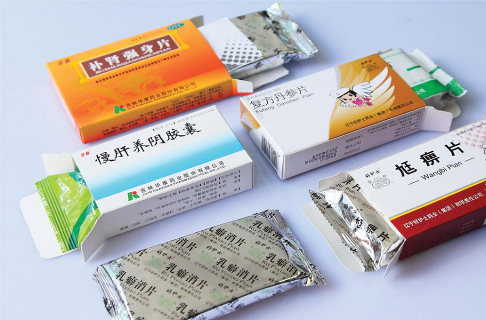 Automatic medicine plate packaging machine