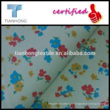 pequeno impresso floral sobre fundo bege médio fino algodão sarja tecido lycra em boa função de estiramento para o vestuário