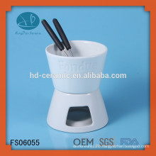 cooking tools,,porcelain fondue set used with folks and candle,White Ceramic Chocolate Fondue With Logo