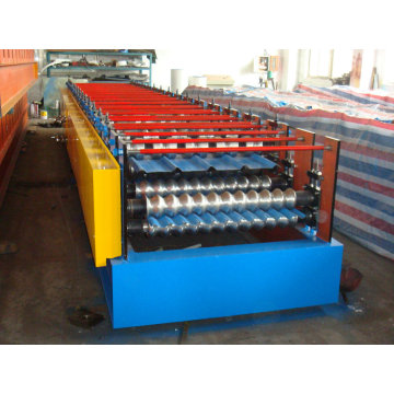 Máquina formadora de rollos de doble capa