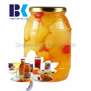 Glass of Canned Yellow Peach in Syrup