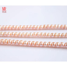 10-11mm Pink Fresh Water Pearl Strand, forte lustre (ES127)
