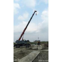 Подъемный кран с телескопической стрелой для строительства здания