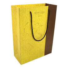Luxury black matte golden logo printed shopping paper bag with rope handles for clothing packaging