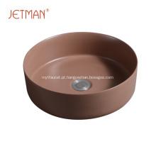 Lavatório de cerâmica de cor marrom