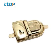 Classical gold color finished handbag parts press wholesale luggage locks metal lock bag lock