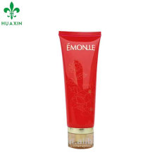 plastic red color cosmetic facial cleaning cream tube witj scrylic cap packaging