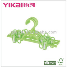 Plastic skirt hanger with clips and a belt rack