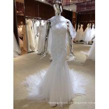 Vestido de novia de sirena con chal de tul
