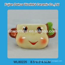 Novel design ceramic cup in smart monkey shape without handle