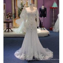 Ajuste y llamarada luz de manga larga ver a través de vestido de novia con apliques