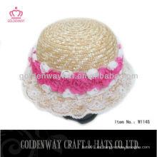 Sombrero de paja de los niños con la flor