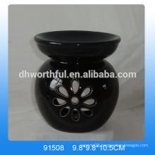 Handmade black ceramic aroma burner with flower shaped hollow-out design