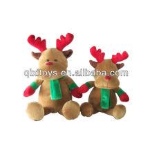 Reno de Navidad con bufanda verde y guantes rojos