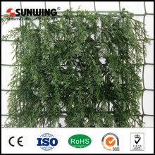 pequeña planta artificial cercas de seto de jardín vertical