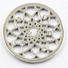 Серебряная монета с белым кристаллом