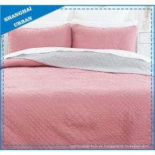 Juego de colchas acolchadas de poliéster reversible rosa liso