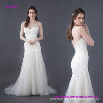 Beautiful Beaded Flower Lace Wedding Gown with a Fitted Long Line Bodice and a Layered Tulle Skirt