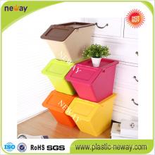 Kleine stapelbare Aufbewahrungsbox aus Kunststoff mit Klappdeckel