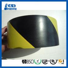Piso del PVC negro amarillo marca cinta de advertencia