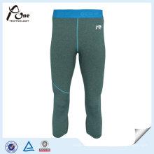 Les hommes élastiques adaptés aux besoins du client usent des pantalons d'entraînement de sports
