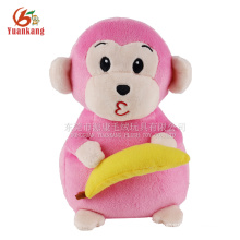 Guangdong recheado macaco-de-rosa com banana brinquedo de pelúcia