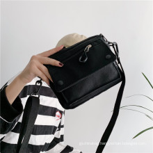 China Supply Fashion designer canvas material popular crossbody sling bags for women girls